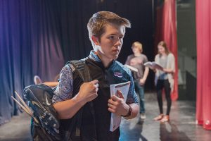 Calvin leaving theatre