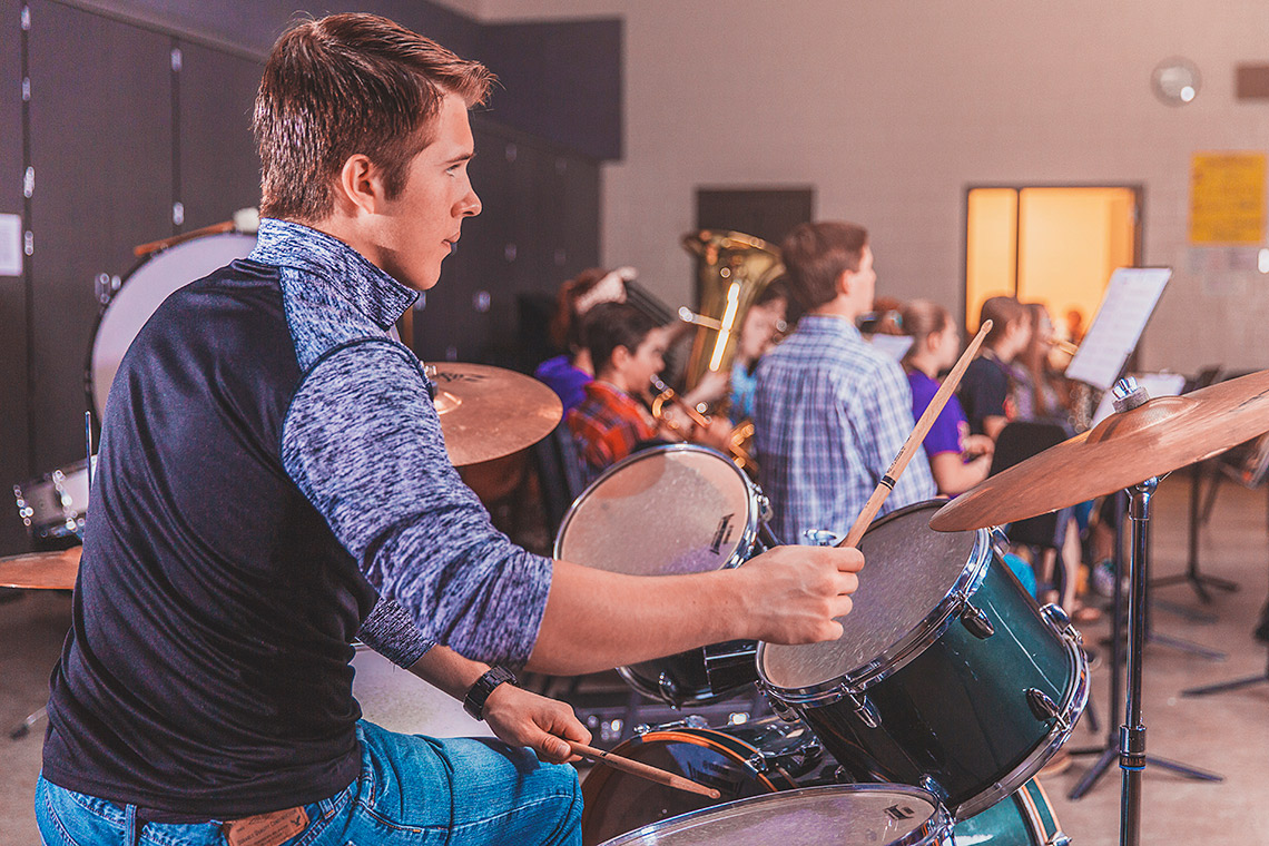 Calvin playing drums