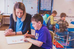 Wyatt with teacher in classroom